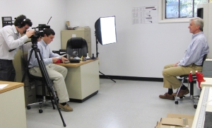 Lafayette College students Max Bergelson, left, and Jake Hyatt interview Sigma President Jerry Lynch about 3D printing.