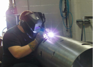 Max Perhach, Sigma certified in-house welder, works on the Ultrasonic Water Treatment System